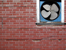 Retro Faux Brick Wall with Fan. Stock Photo