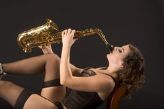 Retro female saxophonist Royalty Free Stock Images