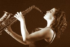 Retro female saxophonist (retro sepia style) Stock Photo