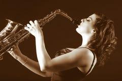Retro female saxophonist (retro sepia style) Stock Photo