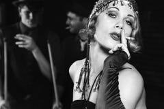 Retro female smoking. Stock Images