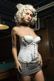 Retro female standing in bar. Royalty Free Stock Photos