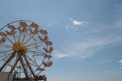 Retro ferris wheel in front of a blue sky, summer nostalgia stock images