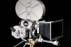 Retro film camera. On black background Royalty Free Stock Photos