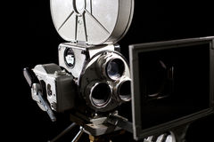 Retro film camera. On black background Stock Photos