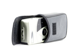 Retro film camera. Front of retro camera with bag in white isolated background Stock Photos