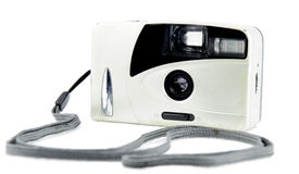 Retro film camera. Front of retro camera in white isolated background Royalty Free Stock Photography