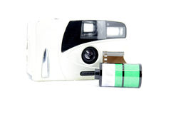 Retro film camera. Front of retro camera with film in white isolated background Stock Photography