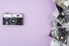 Retro film camera on a pink background. View from above. royalty free stock images