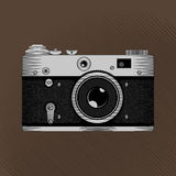Retro film camera. Vintage photo camera in grayscale on the sepia background. Stock vector Royalty Free Stock Images