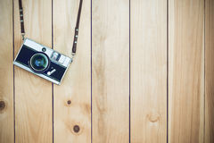 Retro film cameras holding on wood background with free copy spa stock image
