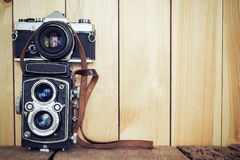 Retro film cameras on wood background with free copy space, vint Royalty Free Stock Photos