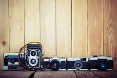 Retro film cameras on wood background with free copy space, vint Royalty Free Stock Photo