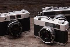 Retro film cameras on wooden background Stock Images