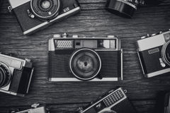 Retro film cameras on wooden background Royalty Free Stock Photo