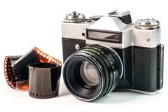 Retro film photo camera isolated on white background. Old analog Royalty Free Stock Photos