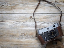 Retro film photo camera. On the wooden background stock photography