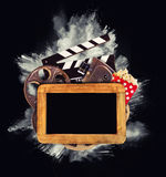Retro film production accessories with powder explosion Royalty Free Stock Images