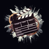 Retro film production accessories with powder explosion Royalty Free Stock Photography