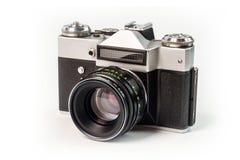 Retro- Filmfotokamera lokalisiert auf weißem Hintergrund Alte Entsprechung Lizenzfreies Stockfoto