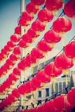 Retro filtered chinese red paper lanterns against blue sky Stock Image
