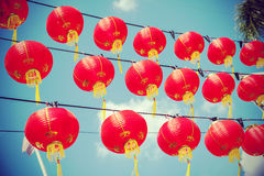 Retro filtered chinese red paper lanterns against blue sky Royalty Free Stock Photos