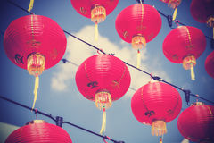 Retro filtered chinese red paper lanterns against blue sky Royalty Free Stock Images