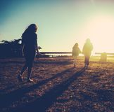 Retro Family Vacation. Retro Filtered Image Of A Mother And Daughters On Vacation By The Ocean At Sunset Stock Image