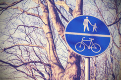 Retro filtered pedestrians and cyclists only sign in a park. Stock Photo
