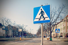 Retro filtered photo of pedestrian crossing signs.  royalty free stock photos