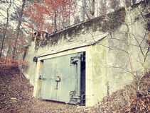 Retro filtered picture of a bunker in forest Royalty Free Stock Images