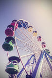 Retro filtered picture of ferris wheel in a park Royalty Free Stock Images