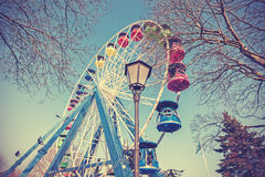 Retro filtered picture of ferris wheel in a park Stock Image