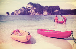 Retro filtered picture of kayaks on a tropical beach. Stock Images