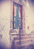 Retro filtered picture of old wooden front door. Royalty Free Stock Photo