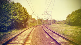 Retro filtered picture of railroad tracks. Vintage retro filtered picture of railroad tracks, old film effect applied royalty free stock image