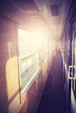 Retro filtered picture of a train coach interior. Stock Image