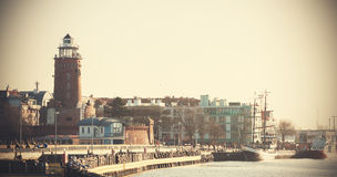 Retro filtered picture of a waterfront in Kolobrzeg, Poland. Royalty Free Stock Photos