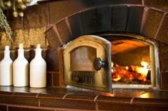 Retro fireplace in the rustic kitchen Stock Image