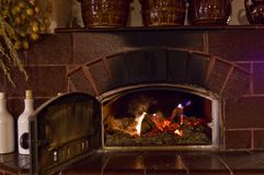 Retro fireplace in the rustic kitchen Royalty Free Stock Image