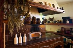 Retro fireplace in the rustic kitchen Stock Images