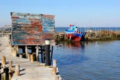 Retro fisherman hut stilts pier boat sea, Portugal Royalty Free Stock Photography