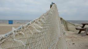 Retro fishing nets on  sea beach Stock Photography