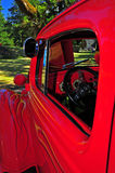 Retro flaming red truck drivers side mirror Stock Photo