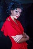 Retro flicka i en röd klänning Fotografering för Bildbyråer