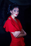 Retro flicka i en röd klänning Royaltyfri Fotografi