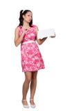 Retro flicka i en rosa klänning arkivbild