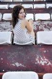 Retro flickasammanträde i stadion Royaltyfria Bilder