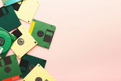 Retro floppy disks isolated on pink background. Old floppy disks isolated on pink background. Border of magnetic retro storage devices, cutout of colorful Royalty Free Stock Image