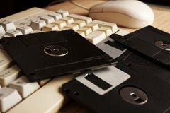 Retro floppy and keyboard on the table Royalty Free Stock Image